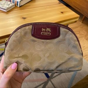 Coach cosmetic case with burgundy leather detail